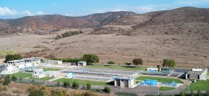 Image of a water treatment facility in front of mountains